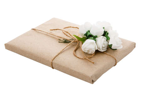 Original gift wrapped in craft paper with floral decor. Isolated on white background a