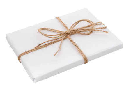 White gift box with burlap ribbon bow isolated