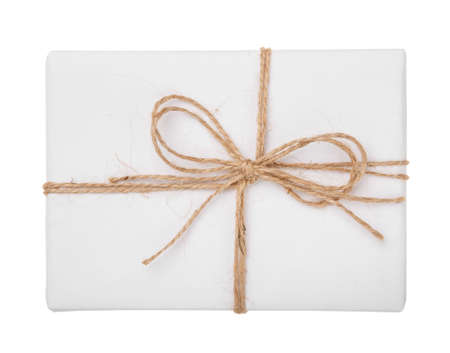 White gift box with burlap ribbon bow isolated with clipping path on white background. Top view. 스톡 콘텐츠