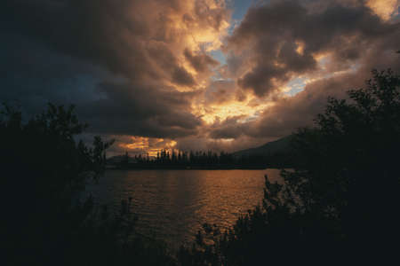 Dramatic overcast sky over Lake Strbske pleso. Dramatic overcast sky over Lake Strbske pleso. Slovakia, Europe. 스톡 콘텐츠