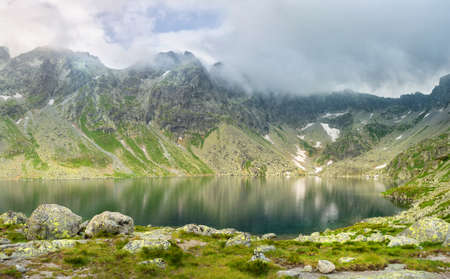 View of the valley in the mountains with the Hincovo pleso pond in the High Tatras. Slovakia. Landscape of nature.