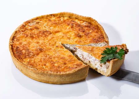 Taking of delicious mushroom pie with a kitchen spatula. Fragrant vegetable pie on white background. Clouse up. 스톡 콘텐츠
