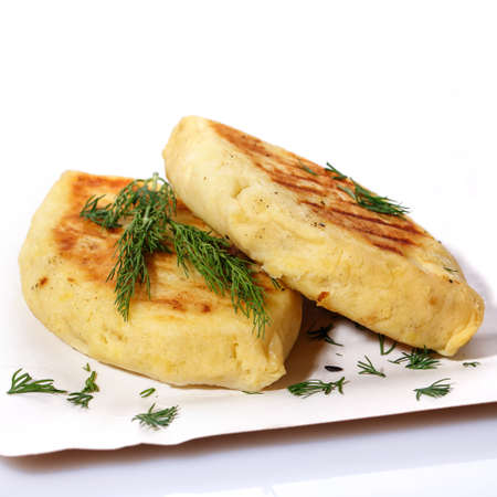 Zrazy with dill on a paper plate on a white background. National Ukrainian, Lithuanian, Polish and Belarusian cuisine. Easy meal idea. 스톡 콘텐츠