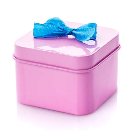 Metallic pink box with blue satin bow close up. Isolated. Congratulations on Women's Day, Mother's Day, Valentine's Day, Happy Birthday.