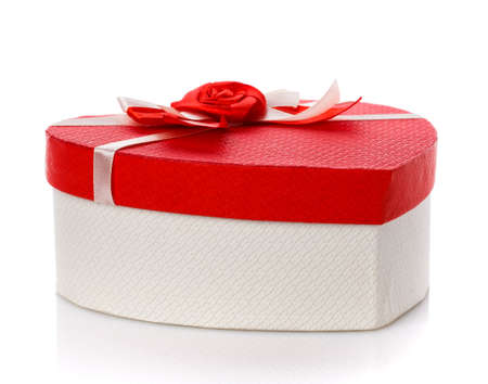 White gift box with red lid and flower on top. Isolated. Close up. 스톡 콘텐츠