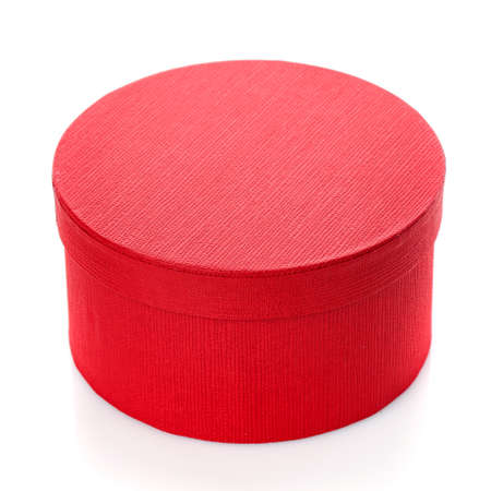 Beautiful round red gift box on a white background. Surprise for the holiday. 스톡 콘텐츠