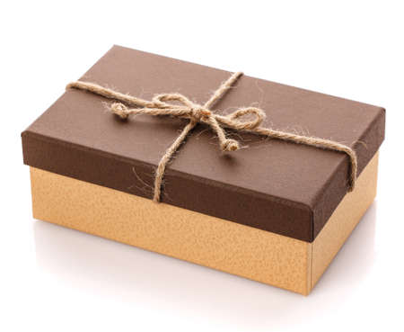 Brown gift box with linen ribbon on a white background. Gift for her husband. Gift for any holiday. Side view.