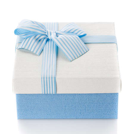 Blue gift box with ribbon and bow. Isolated on white background. Surprise for the holidays. A modern gift for any holiday.
