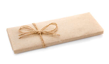 Box wrapped in kraft paper and with burlap ribbon on a white background. 스톡 콘텐츠