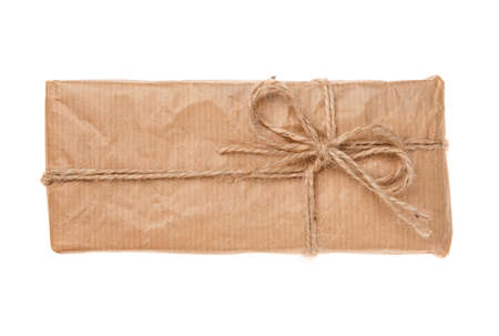 Gift box wrapped in recycled paper with burlap ribbon. Isolated on a white background. Top view.