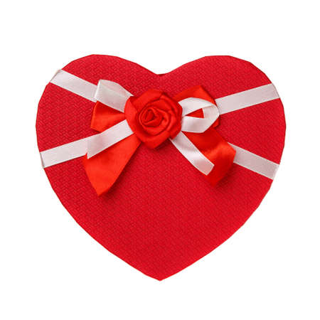 Red gift box in the form of heart with a bow on a white background. Top view. 스톡 콘텐츠