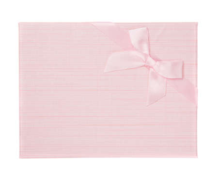 Pink festive gift box with pink bow on white background. Top view.