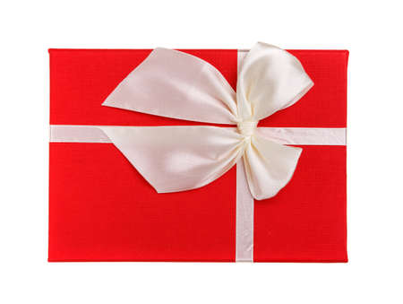 Red gift with white bow on a white background. Isolated. Top view. 스톡 콘텐츠