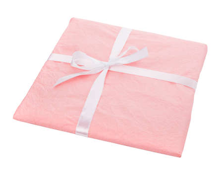 Gift wrapped in pink paper with a white ribbon bow on a white background.