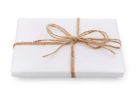 Gift box wrapped in white paper and burlap ribbon.