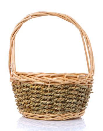 Basket woven in two colors from a natural vine isolated on a white background. Handmade. 스톡 콘텐츠