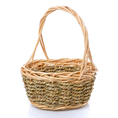 Beautiful basket woven from natural vine isolated on a white background. 스톡 콘텐츠