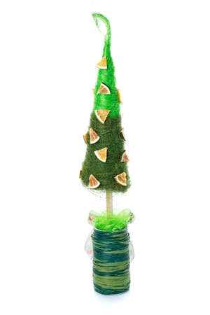 Small Christmas tree for a home interior or office on a white background