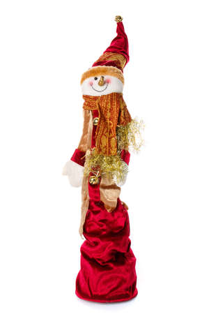 Smiling snowman toy dressed in scarf and cap. Isolated Foto de archivo