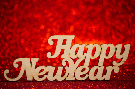 Happy new year text on an abstract red bokeh background Foto de archivo