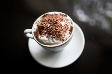 Cappuccino in white cup with chocolate sprinkles Stock Photo - 19220886