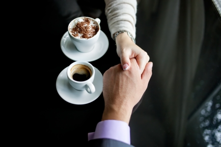 Concept of male and female hands, love and coffee Stock Photo - 19220884