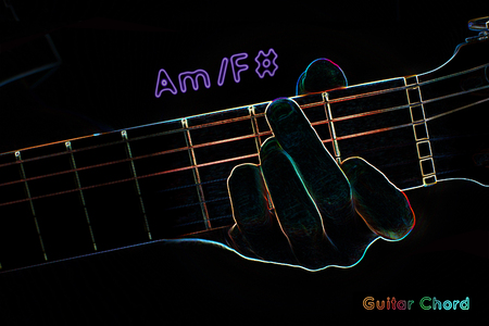 chord: Guitar chord on a dark background