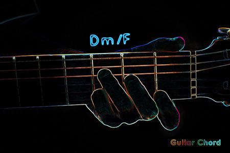 triad: Guitar chord on a dark background, stylized illustration of an X-ray. DmF chord