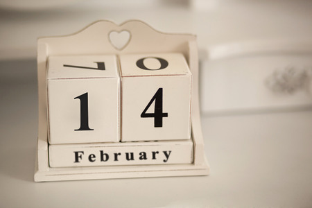 February 14 vintage calenda with a hole in the shape of heart. A holiday - Valentines Day photo