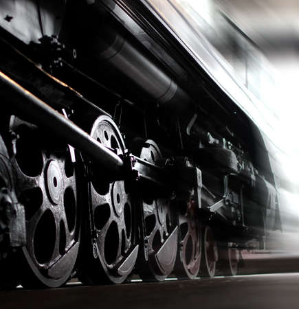Wheels of an old steam locomotive, trains in motion. Close-up shot 版權商用圖片
