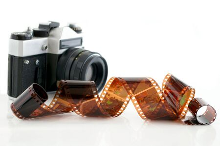 Old camera and film against the white background Stock Photo