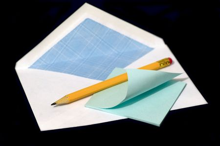 Pencil and note against the black background