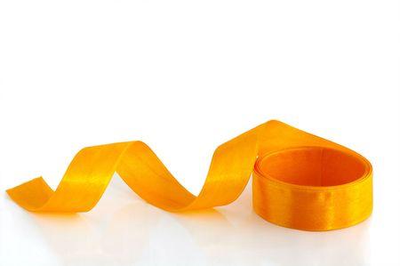 Yellow ribbon against the white background Stock Photo