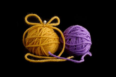 Two balls with yarn against the black background Stock Photo