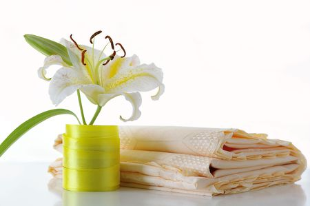 Lily and tablecloth against the white background Stock Photo