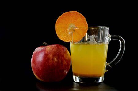 Fruit juice against the black background