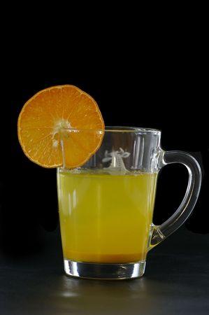 Citrus juice against the black background Stock Photo - 7068484