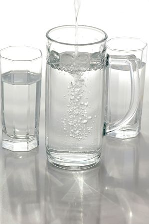 A glass of mineral water on a light background Stock Photo