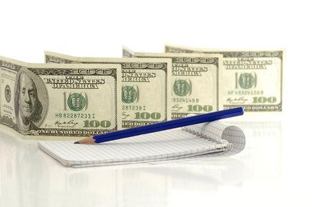 One hundred dollar notes against the white background