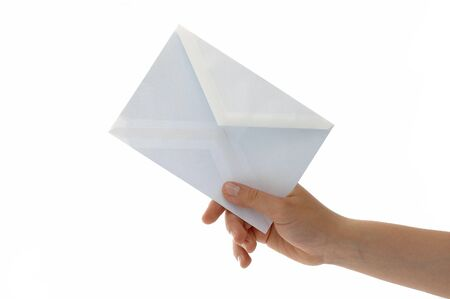 Hand with the envelope against the white background Stock Photo