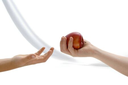 proposes: One child proposes apple to another child  Stock Photo