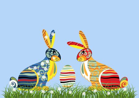 Decorative Easter rabbits against the blue background