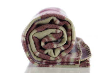 Soft and warm blanket twisted into the cylinder