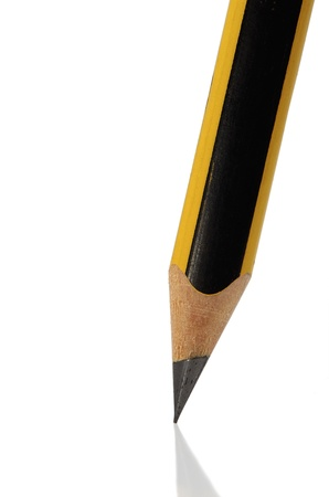 Simple pencil by closeup against the white background