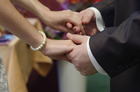 At the wedding ceremony when the guy and the girl are giving each other an oath of love and fidelity  Stock Photo