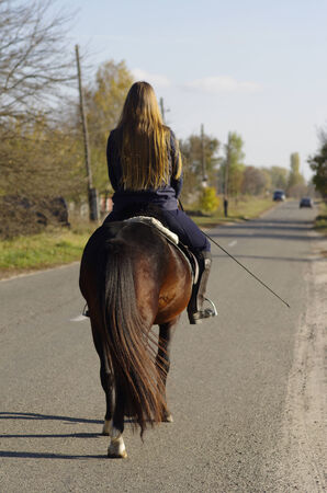 A girl riding a horse in the early morning  Stock Photo