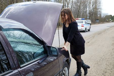 young girl repairs the car Stock Photo