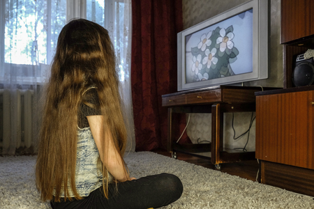 girl watching TV Stock Photo