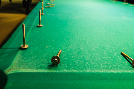 Stock Photo   The Bolts Are On The Felt Pool Table