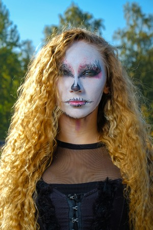 zombie girl with black eyes and bloody mouth
